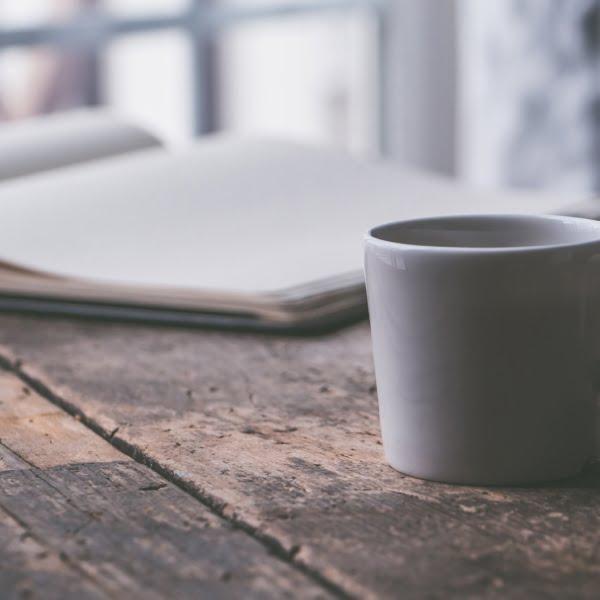 mug of tea with sweetener