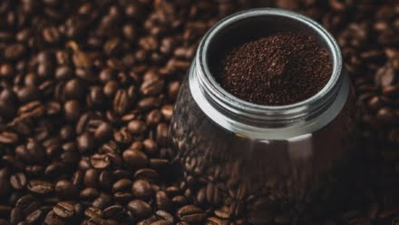 ground coffee on beans