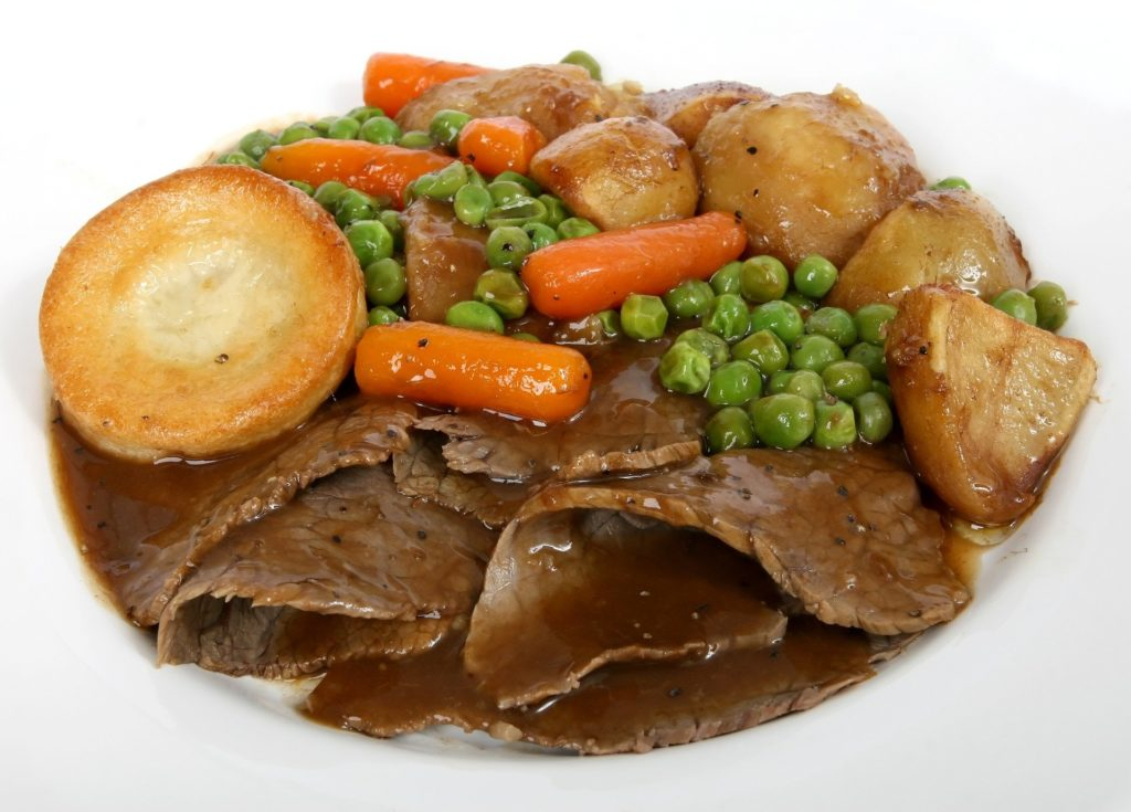 Traditional beef roast dinner with Yorkshire puddings