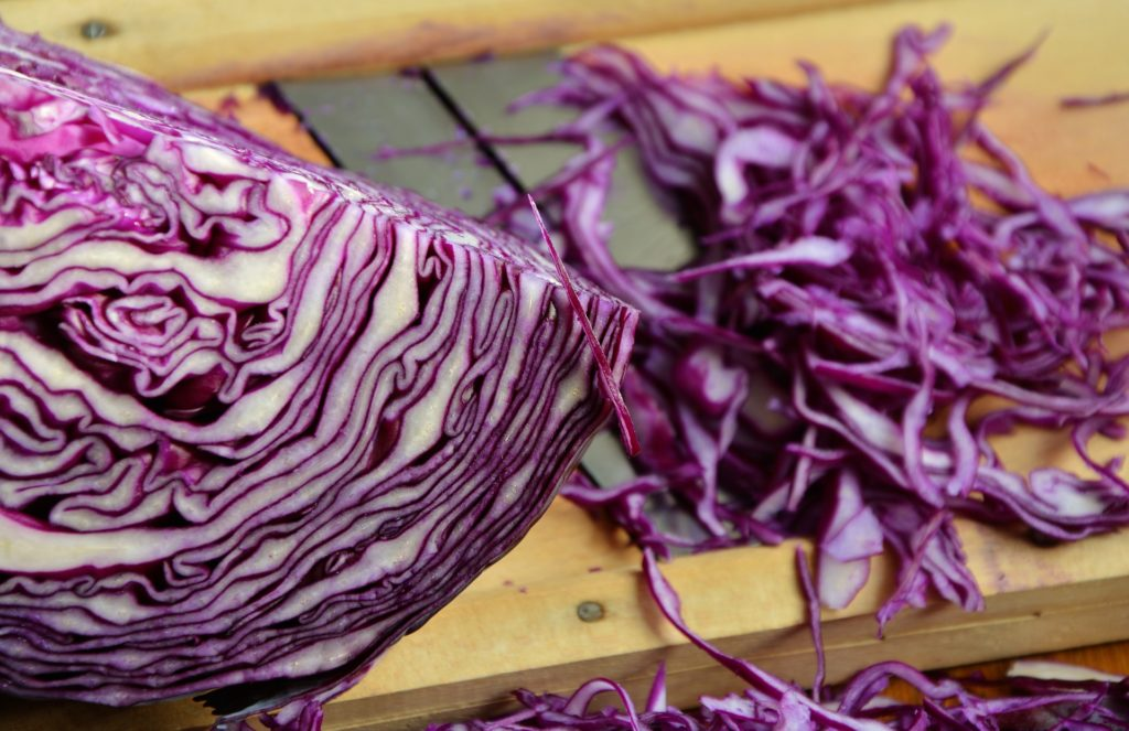Red cabbage, raw on chopping board